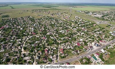 Aerial shot of Kherson city multistoreyed buildings in a sunny day in summer