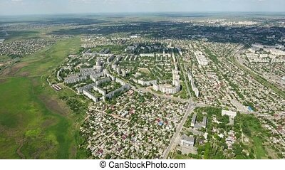 Amazing aerial shot of Kherson city with its multistoreyed buildings, private houses, green parks, which look unusual from a bird`s eye heigh in a sunny day in summer.