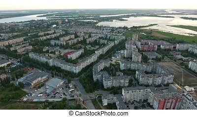Aerial shot of Kherson city with its riverbanks and greenary...