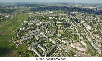 Aerial shot of Kherson in Eastern Europe with apartment blocks and green parks