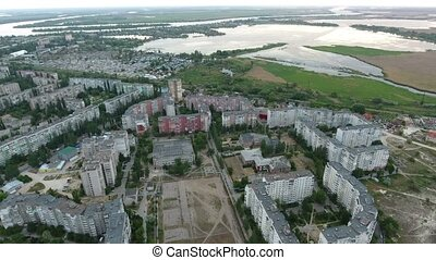 Aerial shot of Kherson outskirts and the Dnipro river curvy...