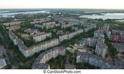 Aerial shot of Kherson with the rows of buildings, its...