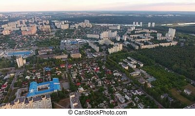 A stunning bird`s eye view of a housing estate in Kiev full of high and small business and private houses, sport facilities in summer