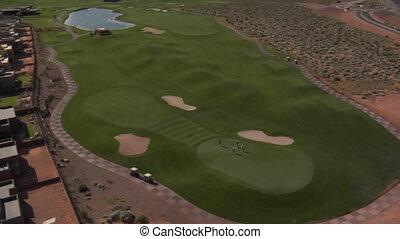 Aerial shot of lake on desert golf course