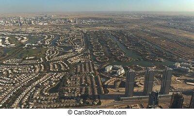 Aerial view of luxury Emirates Hills and Jumeirah Islands communities in Dubai, UAE