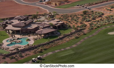 Aerial shot of Mansion on desert golf course