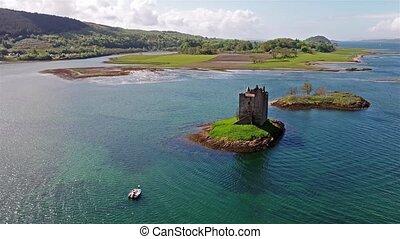 Aerial shot of medieval Castle Stalker on the west coast of...
