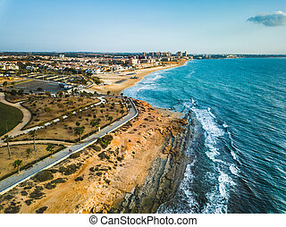 Aerial shot of Mil Palmeras seashore, Spain