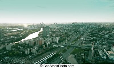 Aerial shot of Moscow residential and industrial areas in the evening, Russia.