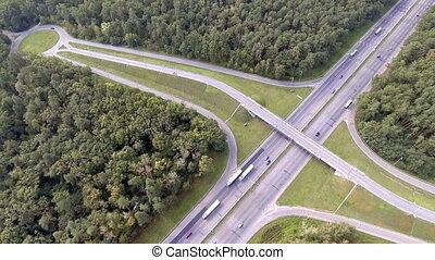 Aerial shot of motorway, freeway traffic - trucks and cars...