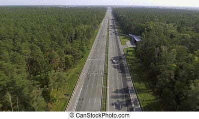 Aerial shot of motorway, freeway traffic - trucks and cars...