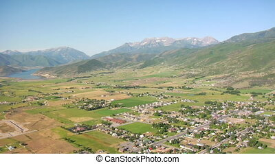 aerial shot of mountain farming community