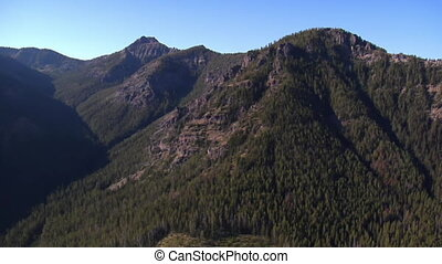 aerial shot of mountain peaks and cliff walls