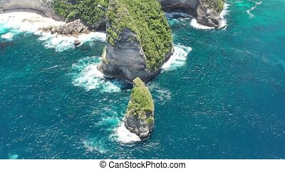Aerial shot of Ocean Waves on Tembeling Coastline at Nusa...