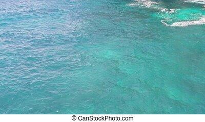 Aerial shot of Ocean Waves on Tembeling Coastline at Nusa...