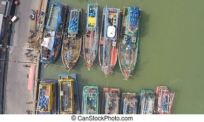 Aerial shot of old fishing vessels, Thailand clip