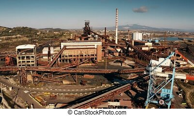 Aerial shot of old industrial facility near Piombino, Italy...