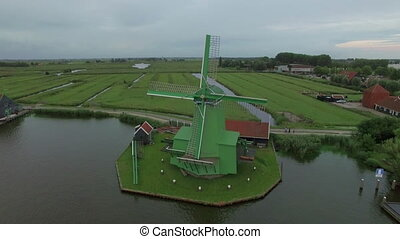 Aerial shot of old windmills and fields in Netherlands