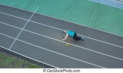 Aerial shot of overweight woman doing push ups - Drone view...