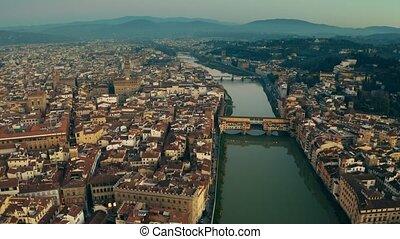 Aerial shot of Ponte Vecchio historic bridge and cityscape...