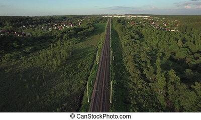 Aerial shot of railway running through the village, Russia