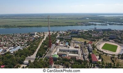 Aerial shot of red and white TV tower on the Dnipro bank...