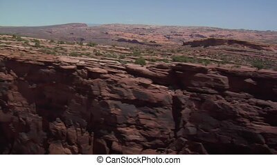 aerial shot of red rock cliffs faces