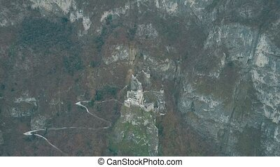 Aerial shot of ruined historic Haderburg Castle in Salorno,...