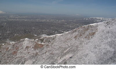 aerial shot of Salt Lake City and mountains in winter