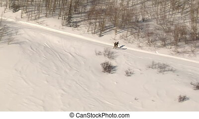 aerial shot of skier and snowboarder on Track