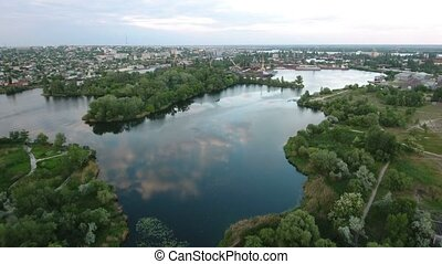 Aerial shot of small islets and green riverbanks of the Dnipro river in summer