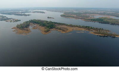 Aerial shot of small islets on the Dnipro river with cuvry coastine and inflows