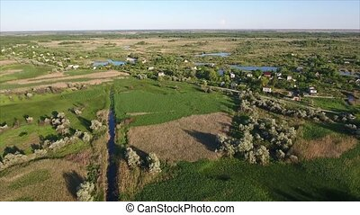 Aerial shot of small lakes, summer cottages and reedbeds in Ukraine in summer