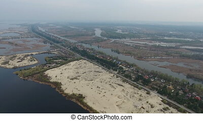 Aerial shot of small sandy islets on the Dnipro river with cuvry inflows