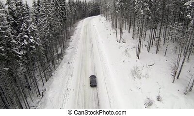 Aerial shot of snow-covered road in the countryside Carpathian Mountains