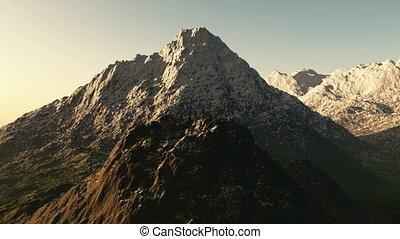 Aerial shot of snowy mountain peak