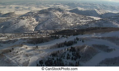 aerial shot of snowy mountains and Park city Utah