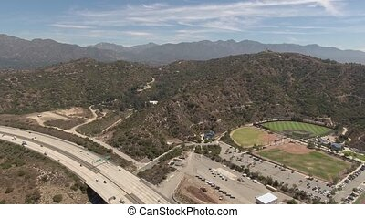 Daytime aerial shot over soccer fields and surrounding areas in Glendale, California