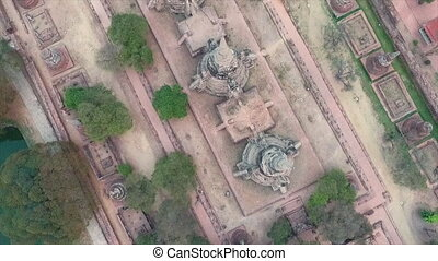Aerial shot of stupas - An aerial shot of old stupas close...