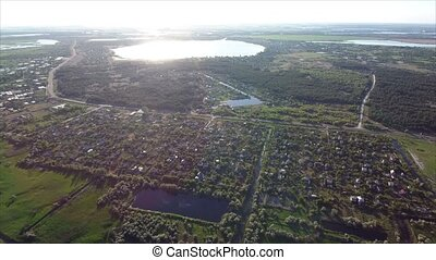 Aerial shot of summer cottages, big and small lakes in the south of Ukraine