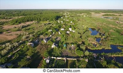 Aerial shot of summer cottages, small lakes and reedbeds in Ukraine in summer