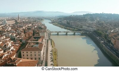 Aerial shot of the Arno river and cityscape of Florence,...