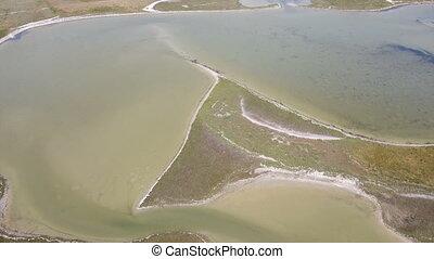 Aerial shot of the Black Sea coast with sand spits, sedge,...