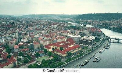 Aerial shot of the city of Prague involving Vltava...