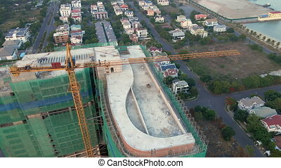 Aerial shot of the construction site with one onstruction crane. Tall building construction concept