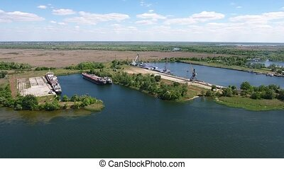Aerial shot of the Dnipro and its docks and ships in Kherson region in summer