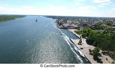Aerial shot of the Dnipro and its Kherson city embankment in a sunny day