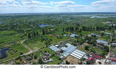 Aerial shot of the Dnipro basin with country roads, houses, greenary in summer