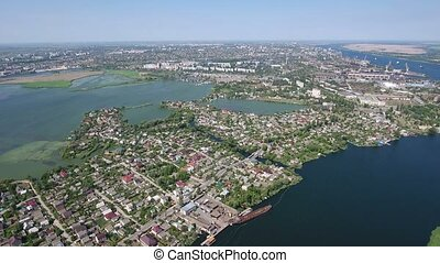 Aerial shot of the Dnipro river and Kherson city embankment in early spring