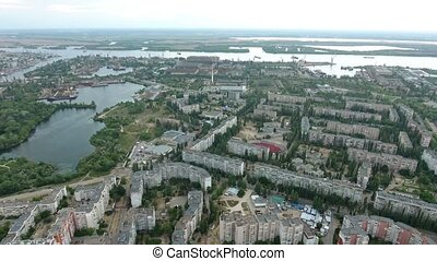 Aerial shot of the Dnipro river and Kherson cityscape in a...